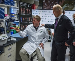 Monday, March 21, 2016. Vice President Joe Biden talking with Dr. Joshua Veatch during his walking tour of Stan Riddell's lab at the Fred Hutchinson Cancer Research Center. Senator Patty Murray is to the right and Dr. Phil Greenberg is in the rear.